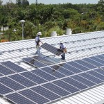 Installers place photovoltaic module at Naples Botanical Garden