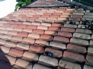 Tile roofs get dirty, but solar panels protect the roof.