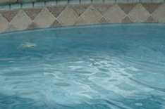 The water level in this pool is a couple of inches too low. The water should come up about half way on the tile in most pools.